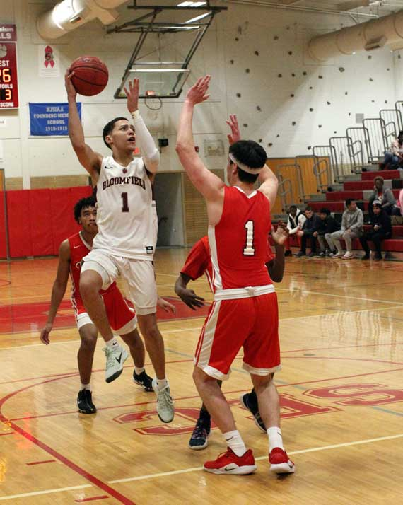 Bloomfield HS boys basketball team defeats Columbia